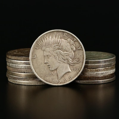 Fourteen Circulated Peace Silver Dollars