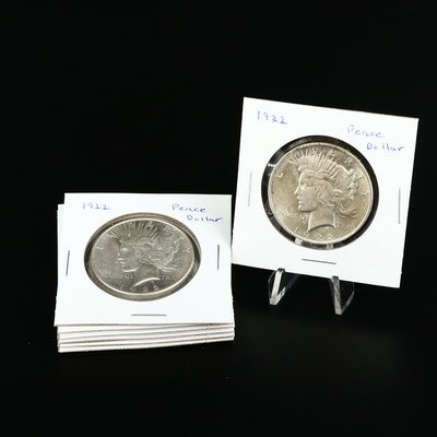 Seven High Grade Peace Silver Dollars