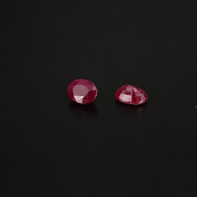 Matched Pair of Loose 2.47 CTW Oval Faceted Rubies