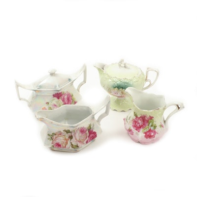 Hand-Painted Porcelain Creamers and Sugar Bowls, Late 19th/Early 20th Century