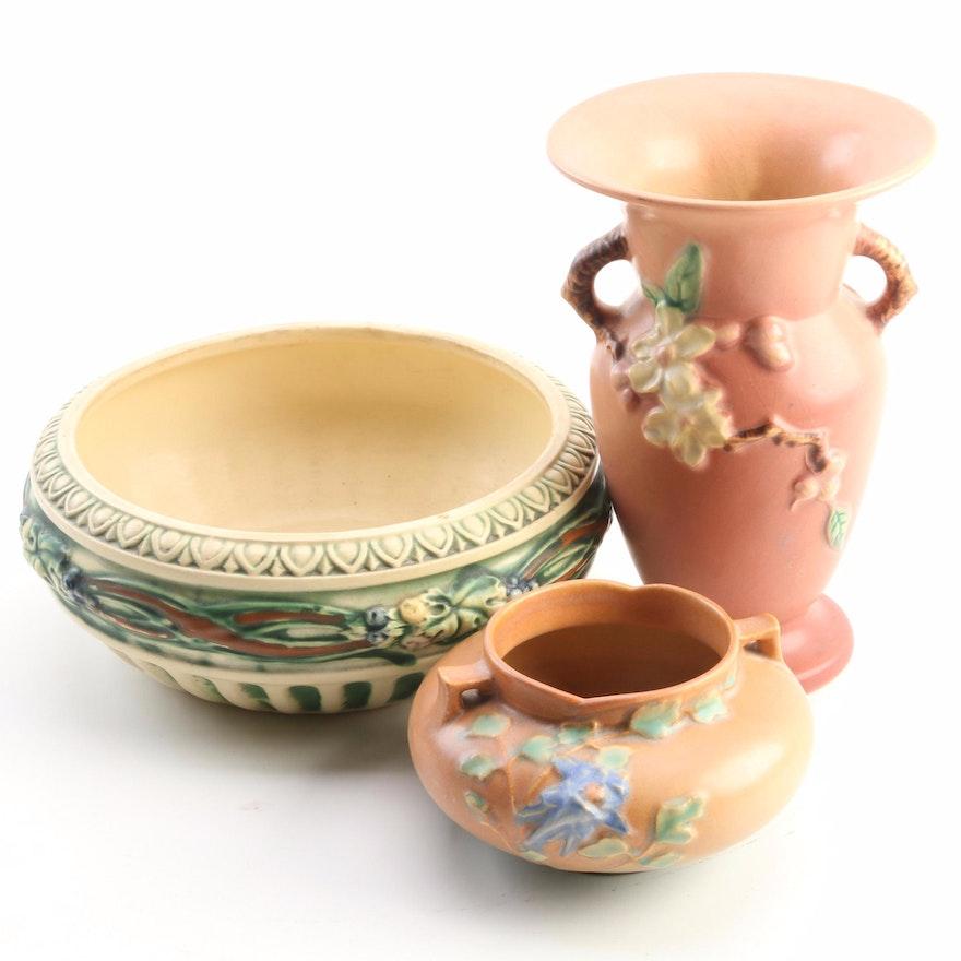 "Roseville ""Corinthian"" Jardinière, ""Columbine"" Vessel, and ""Apple Blossom"" Vase"