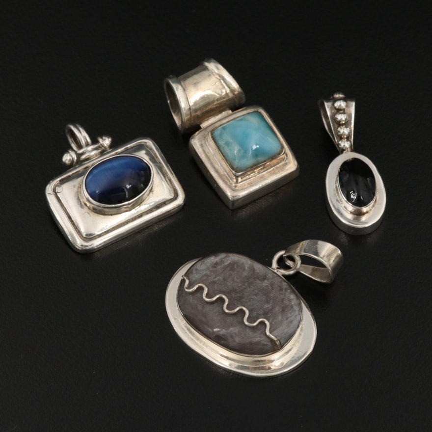 Sterling Silver Pendants Featuring Larimar and Mexican Pieces