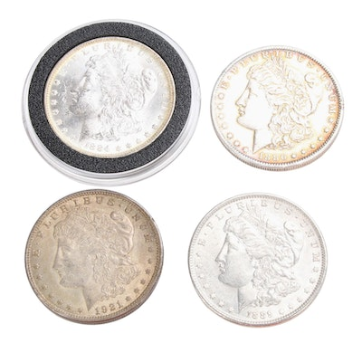 Four Morgan Silver Dollars