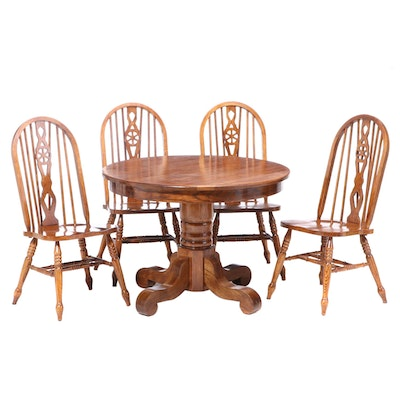 Oak Pedestal Dining Table with Brace Back Chairs and Insert Leaf