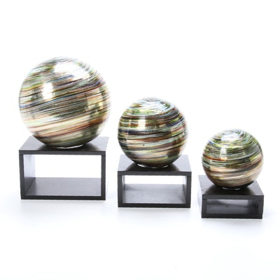 Three Hand-Blown Art Glass Orbs with Wood Stands