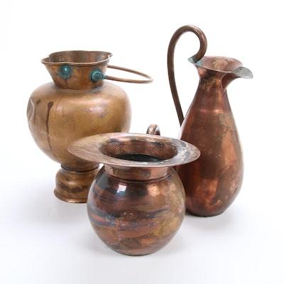 Set of Three Copper Pitchers