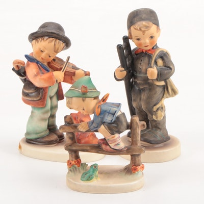 "Goebel Hummel ""Puppy Love,"" ""Chimney Sweep,"" and ""Retreat to Safety"" Figurines"