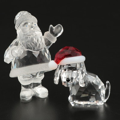 "Swarovski Crystal ""Santa Claus"" and ""Dog with Santa Hat"" Christmas Figurines"