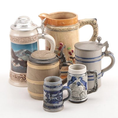 German and Japanese Stoneware Beer Steins and Pitcher Including Gerz
