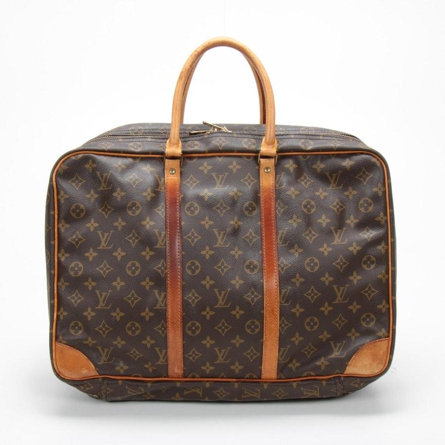 Louis Vuitton Porte-Documents Voyage Bag in Monogram Canvas and Vachetta Leather