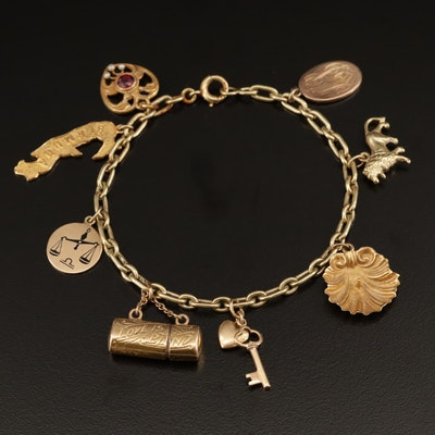 14K Charm Bracelet Featuring 14K and 9K Charms with Garnet and Pearl Accents