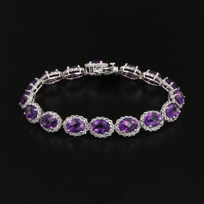 Sterling Silver Amethyst Oval Link Bracelet with Topaz Halo