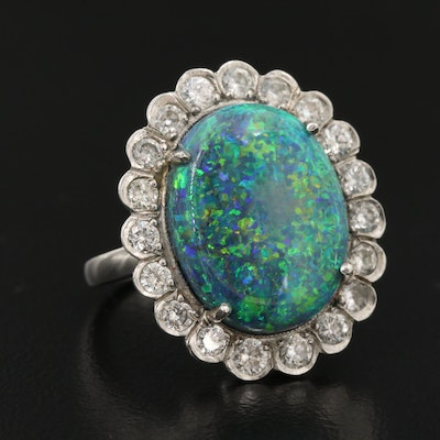 Platinum 7.16 CT Opal and 1.14 CTW Diamond Halo Ring