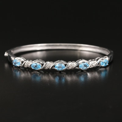 Sterling Silver Topaz and Diamond Oval Hinged Bangle
