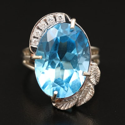 14K 16.79 CT Topaz and Diamond Ring