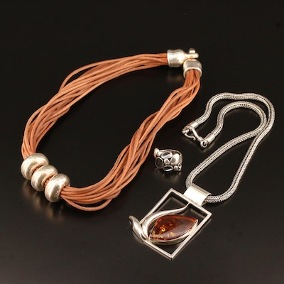 Sterling Silver Necklaces Featuring Amber and Suede