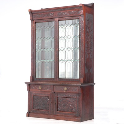 Cincinnati Art Carved Walnut and Leaded Glass Display Cabinet, dated 1890