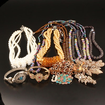 Necklaces, Brooches, Bracelets and Hair Accessories Featuring Peacock Motifs