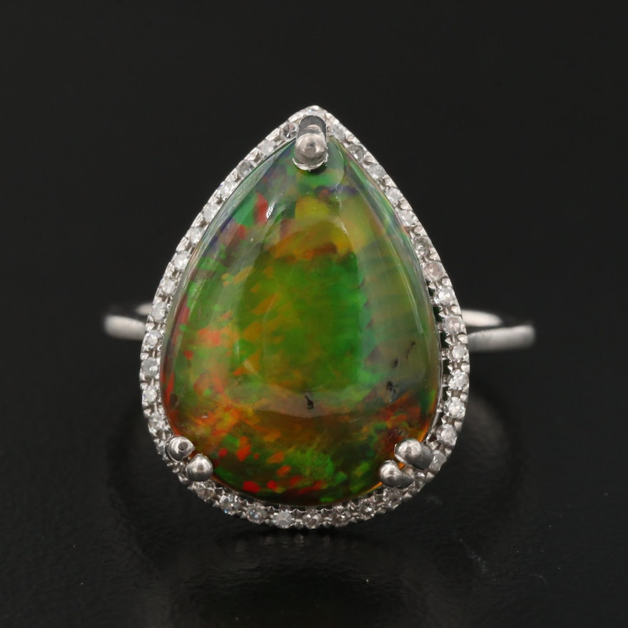 14K 4.17 CT Opal and Diamond Halo Ring with GIA Report