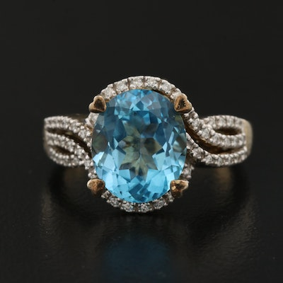 Sterling Silver Blue Topaz and Diamond Ring with Swirl Design and Heart Prongs