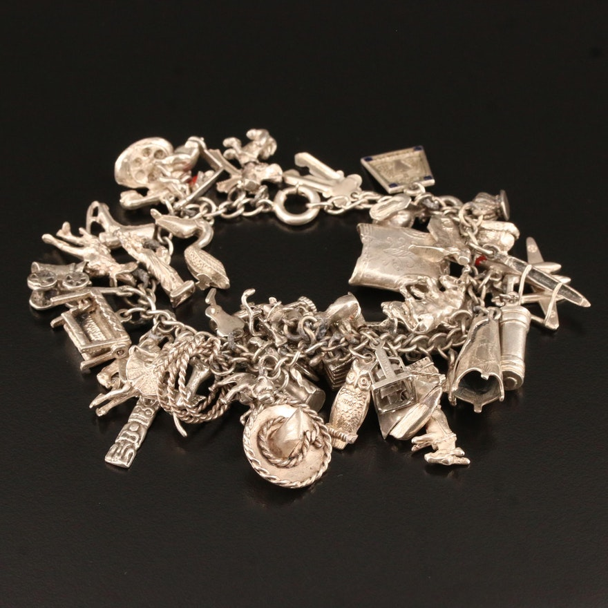 Sterling Silver Charm Bracelet Featuring Articulated and Vintage Charms