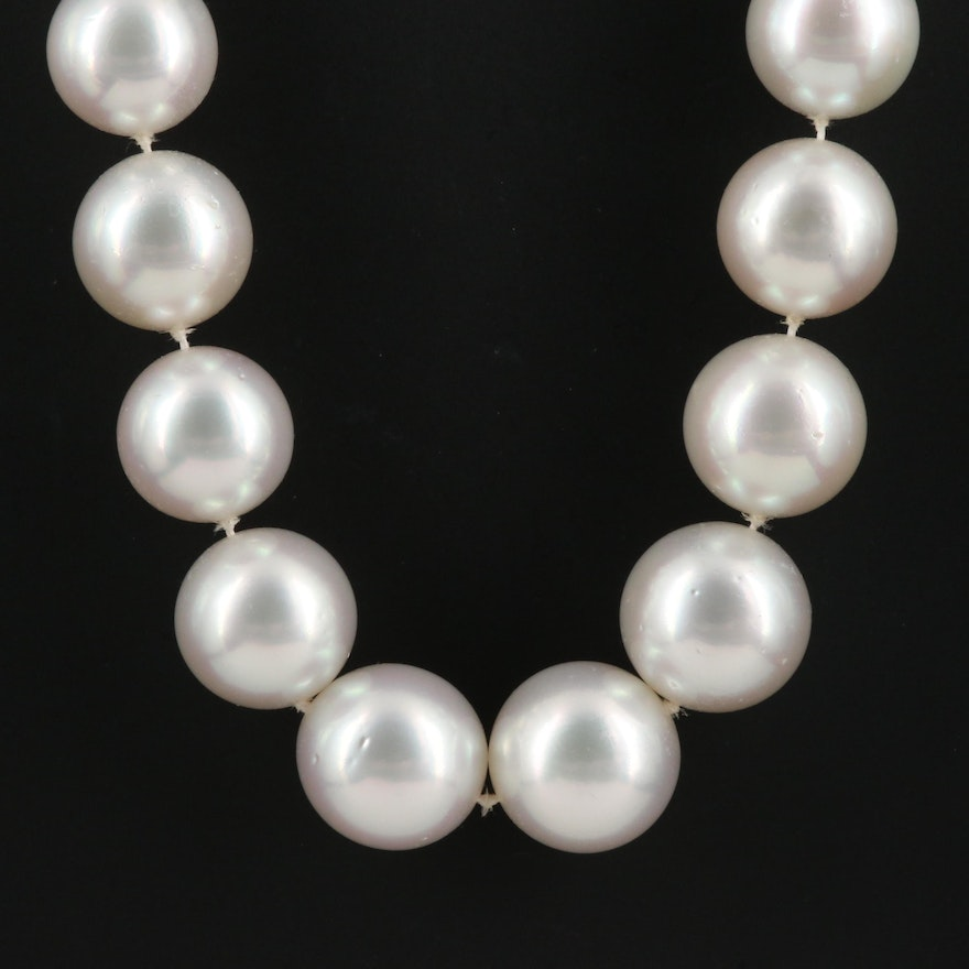 Strand of Pearls with 18K Gypsy Set Diamond Accented Clasp
