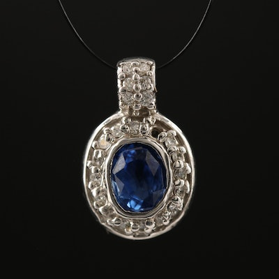 14K Oval Faceted Sapphire and Diamond Halo Pendant