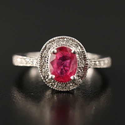 14K 1.40 CT Oval Faceted Ruby and Diamond Halo Ring