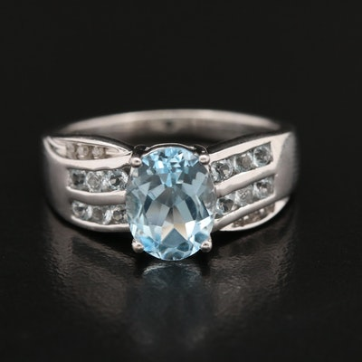 Sterling Oval Faceted Topaz and Diamond Crossover Style Ring