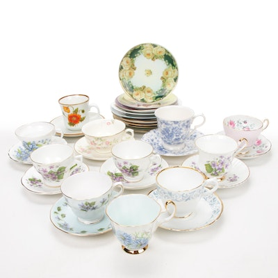 Hand-Painted Display Plates and Teacup Assortment