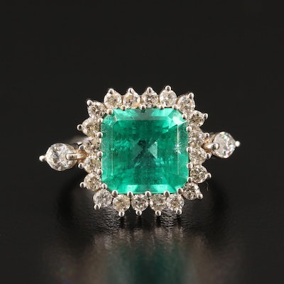 18K 4.19 CT Emerald and 1.03 CTW Diamond Halo Ring with AGL Prestige Report