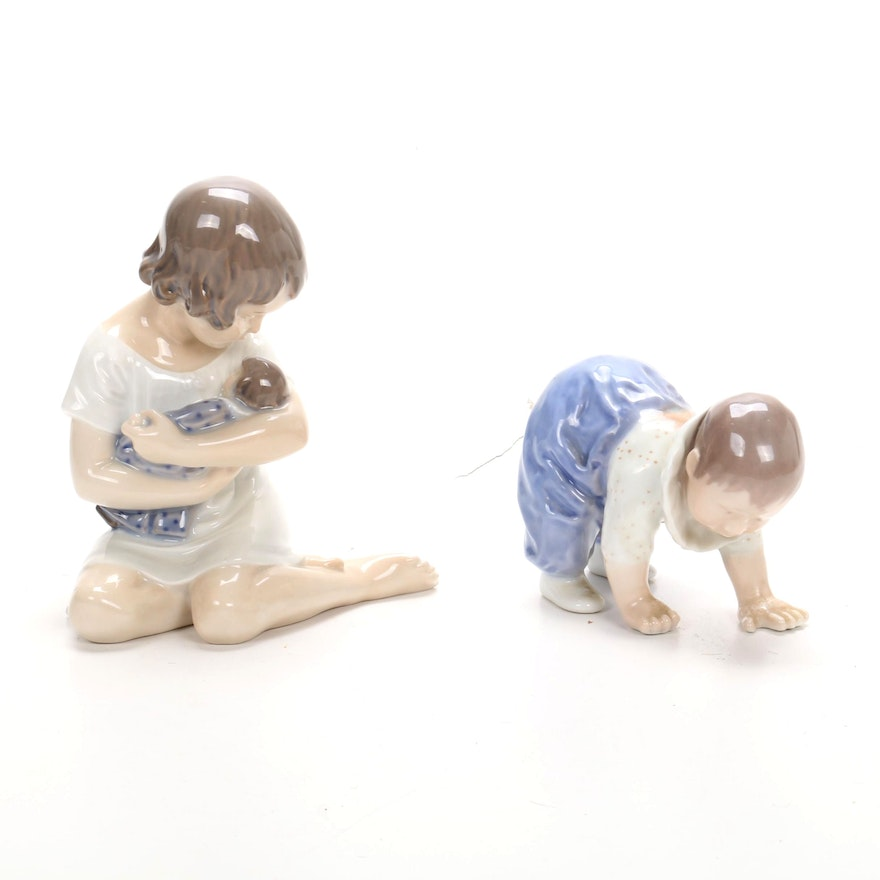 Royal Copenhagen Porcelain Girl with Baby and Crawling Child Figurines