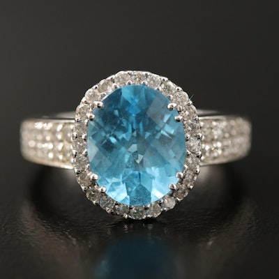 18K Swiss Blue Topaz and Diamond Halo Ring