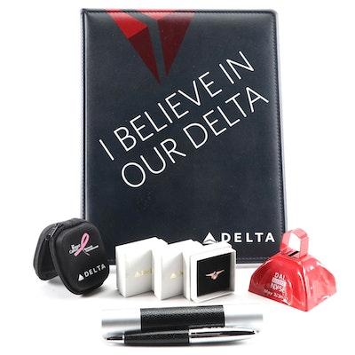 Delta Airlines Memorabilia Including Pen, Padfolio, Lapel Pins, and More