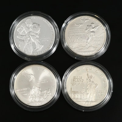 Four US Mint Commemorative Silver Dollars
