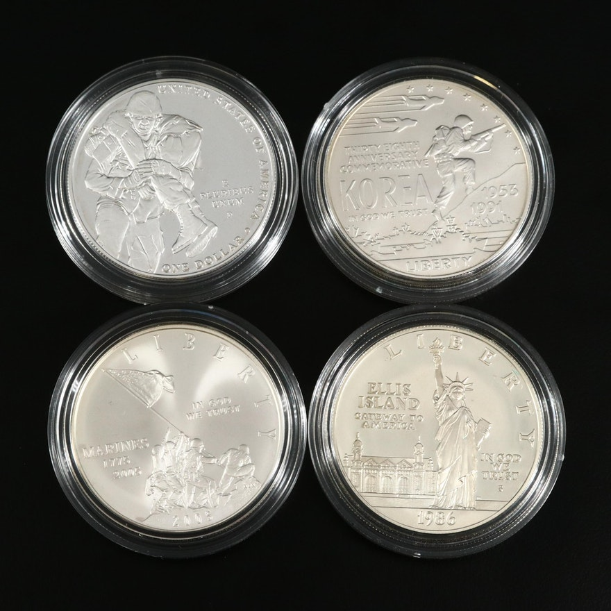 Four US Mint Commemorative Silver Dollars