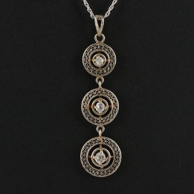 10K Diamond Graduating Pendant on a 14K Singapore Chain Necklace