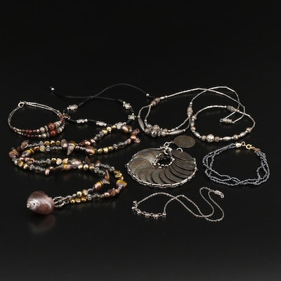 Selected Jewelry Assortment Featuring Tiger's Eye and Art Glass