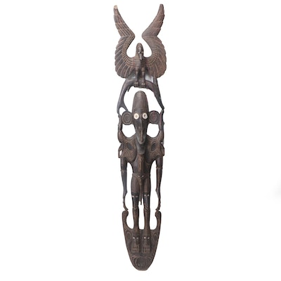 Sepik River Region Carved Figure with Animal Motif and Shell Inlay