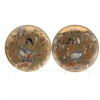 Japanese Satsuma Pair of Ceramic Plates of Shinto Rakans, 20th Century