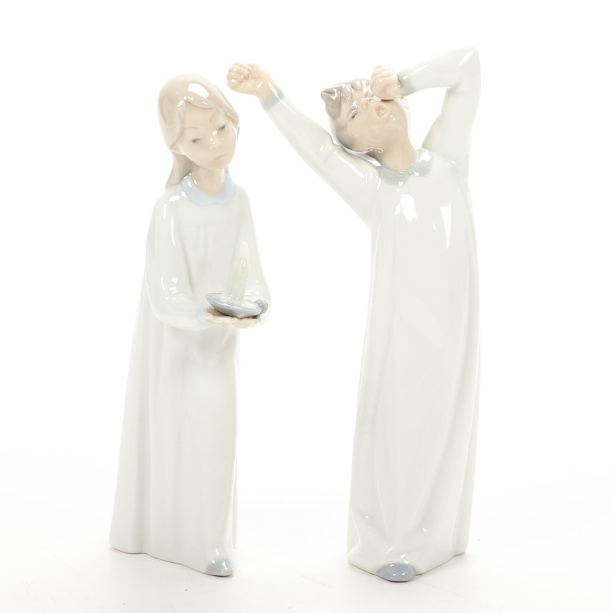 "Lladró ""Boy Yawning"" and ""Girl with Candle"" Porcelain Figurines"