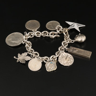 Fine Silver Charm Bracelet with Mixed Silver Coins and Charms