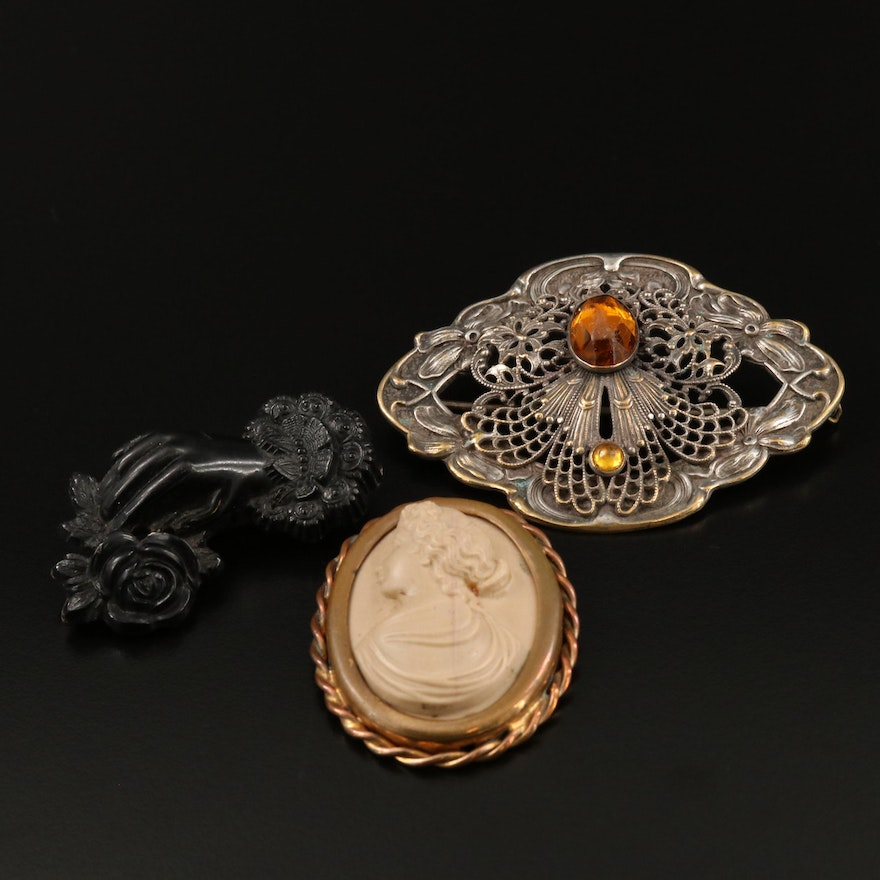 Collection of Antique Brooches Featuring Carve Black Coral and Lava Cameo