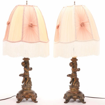 Pair of Rococo-Style Cherub Form Metal Table Lamps with Fringe Shades