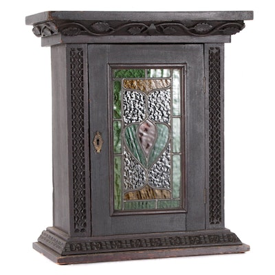 Arts and Crafts Carved Ebonized Wood and Leaded Glass Wall Cabinet