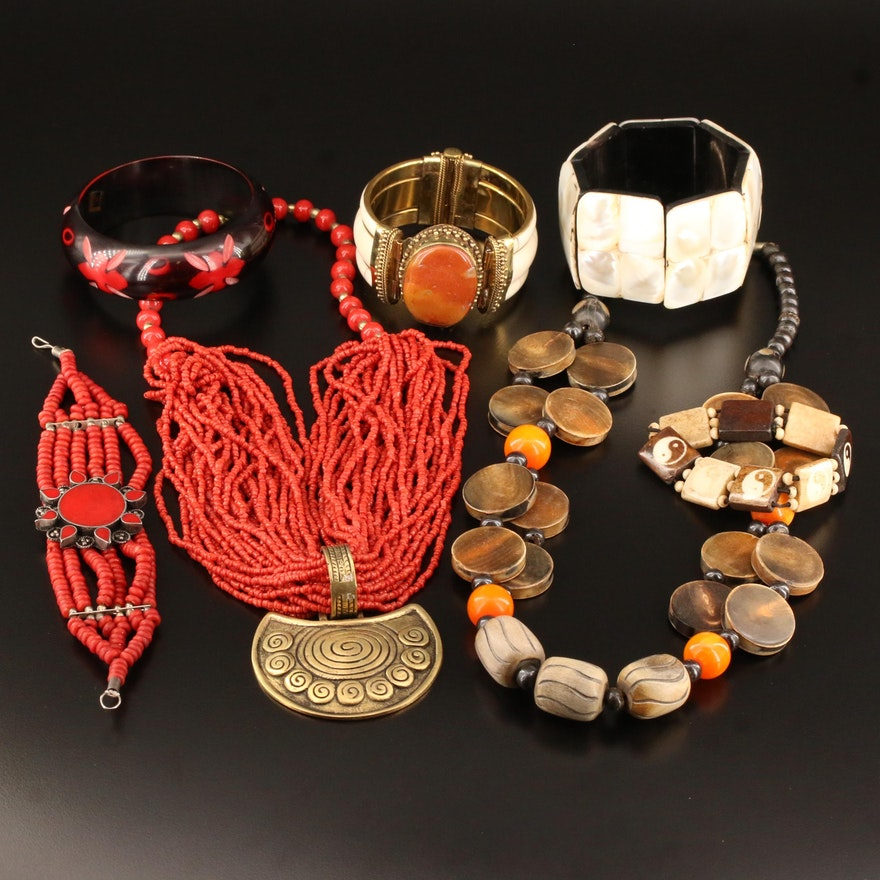Assorted Wood and Gemstone Jewelry Featuring Tribal Designs