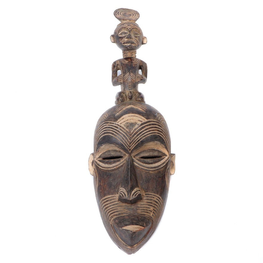 Igbo Style Carved Wood Mask with Figure Atop, Nigeria