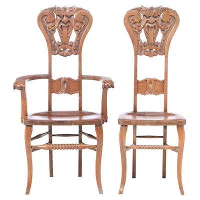 "Two American Carved Oak ""North Wind"" Chairs, circa 1900"