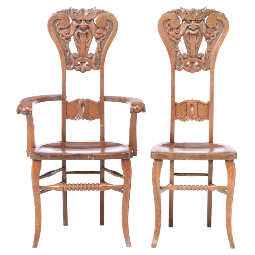 """Two American Carved Oak """"North Wind"""" Chairs, circa 1900"""