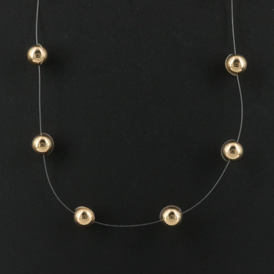 14K Floating Beaded Necklace with Filament Cord